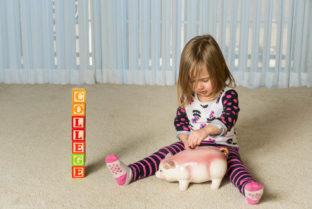 Young Girl On Floor Of Home Saving Money